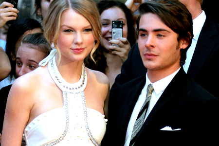 "Taylor Swift poses with Zac Efron on the red carpet at the Australian Premiere of ""17 Again."""