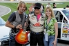 T.J. Bell of Red Horse Racing was presented a guitar at the Texas Motor Speedway courtesy of The Roys and Peavy
